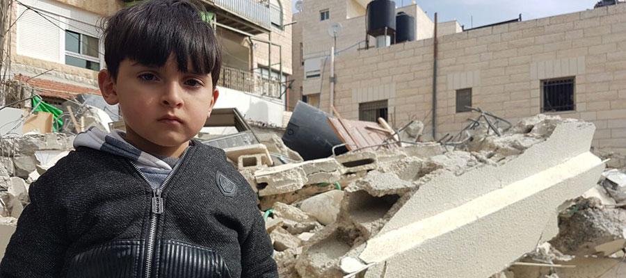 boy standing on rubble