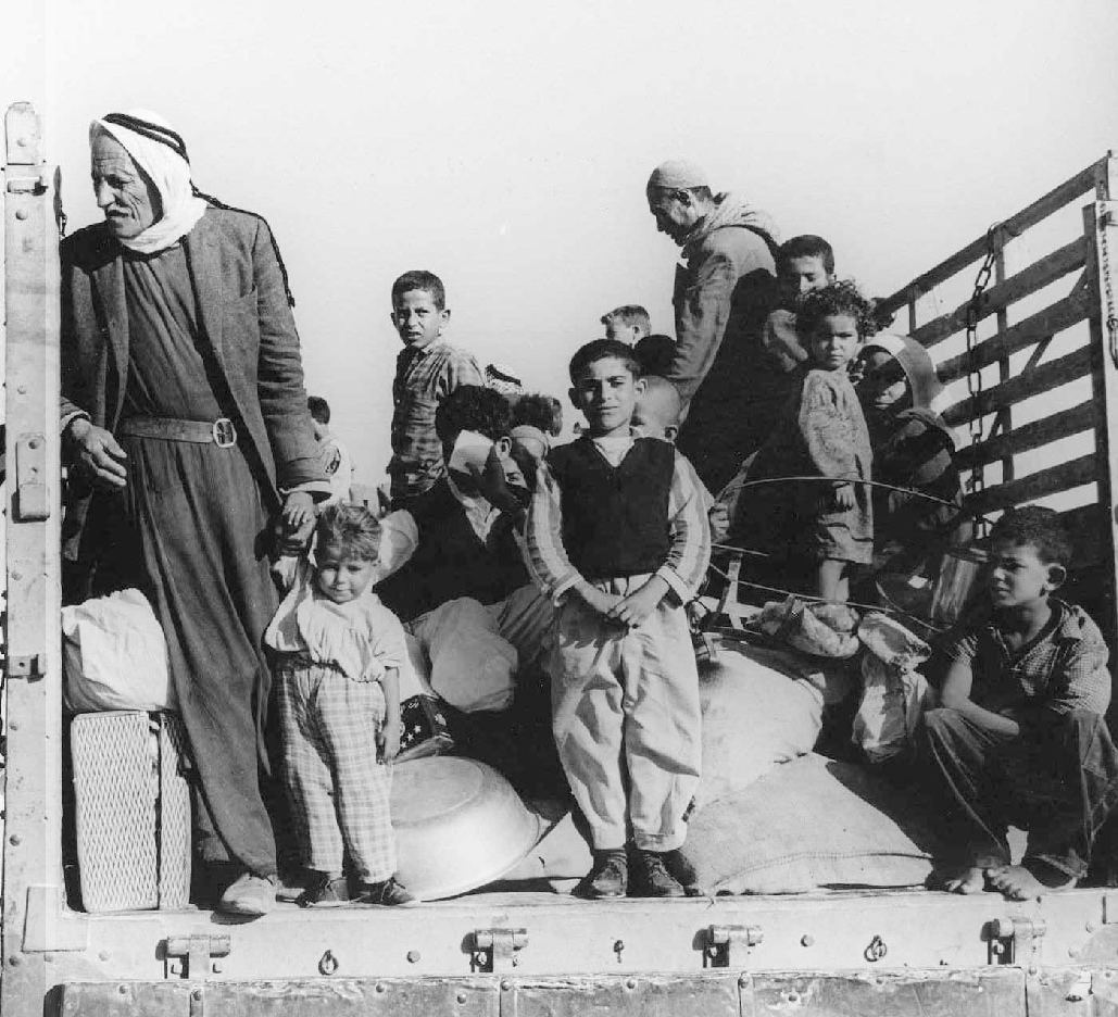 Palestinian refugees being trucked out of their village, circa 1948.